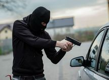 Two children stop car robbers from stealing their father's car