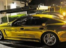Police officers seize man's gold Porsche car for being too shiny