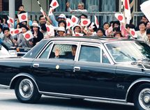 Auto royalty! Japan' new emperor rides a Toyota Century convertible limo for his coronation