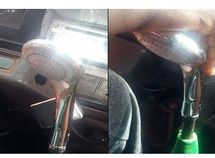 Only in Lagos! Danfo bus driver spotted using shower head as gear stick!