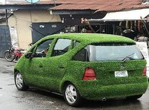 A car wrapped up in artificial green grass spotted in Surulere, Lagos