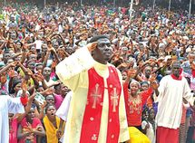 Father Ebube Muonso in Anambra bought 8 cars for his church workers as Christmas gift