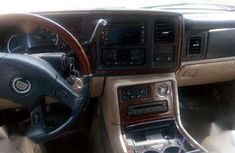 QUICK SALE: 2004 October Prestigious, Platinum Cadillac Escalade