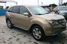 Clean 2008 model Acura MDX gold colour
