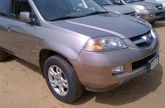 Clean Acura MDX gold colour 2005 model