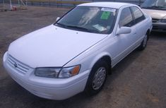 1999 Charming white clean Toyota Camry tiny lite