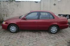 Nice red Toyota Corolla 2001 for sale
