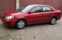 2005 Red tokunbo Toyota Corolla le for sale