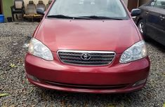 2005 Charming red first grade tokunbo Toyota Corolla le