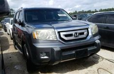 Clean 2011 Grey Honda Pilot for sale ac/filtered and good working conditions