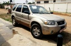 Clean first hand use perfect condition 2006 Gold Ford Escape with leather interior For sale