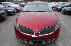 Clean Lincoln MKS 2013 red for sale
