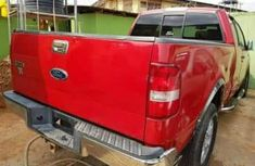 Ford Hilux 2010 Red for sale at a cheaper rate