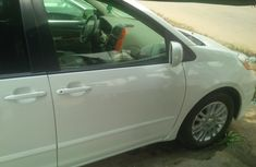 Tokunbo 2009 White Toyota Sienna Limited AWD For Sale with full option