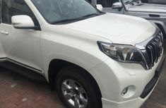 Clean Toyota Land Cruiser Prado jeep 2015 White for sale with full auction