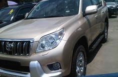 Clean Toyota Land Cruiser Prado jeep 2011 Gold for sale with full auction