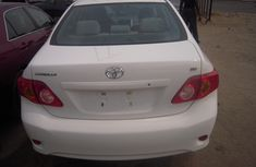 Clean Toyota Corolla 2010 White for sale with full auction