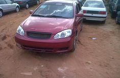 Clean Toyota Corolla 2004 red for sale with full auction