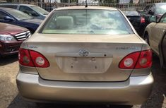Clean Toyota Corolla 2004 Gold for sale with full auction