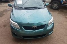 Clean Toyota Corolla 2010 green for sale