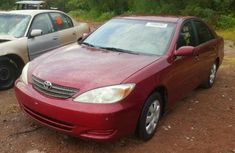 Very neat and clean Toyota Camry 2004 red for sale with full option factory fitted air conditioner