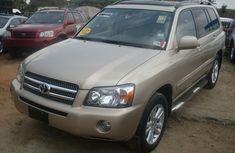 Toks Toyota Highlander 2005 gold for sale with the fullest options