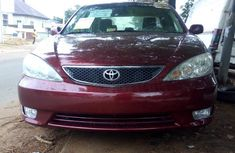 Toyota Camry 2006 red model for sale with the fullest options buy and drive
