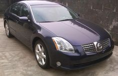 Toks 2004 Blue Nissan Maxima for sale with the fullest option buy and drive vehicle.