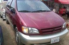 Toks Toyota SIENNA 2000 red for sale with the fullest options