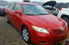 VERY CLEAN TOYOTA CAMRY 2013 RED FOR SALE,  CALL PASTOR SAM FOR PURCHASE  08106946965