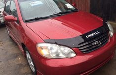Clean Toyota Corolla 2002 red for sale