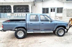 Clean Toyota Hilux 2004 blue in a perfect sound and good working condition for sale