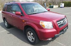 Clean Honda Pilot for sell Red colour 2004 model