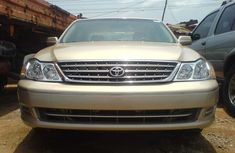 Direct 2003 gold Toyota Avalon for sale