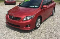 Clean Tokunbo Toyota Corolla 2012 red for sale