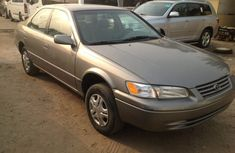 Clean Tokunbo Toyota Camry 1999 Gray LE For Sale.