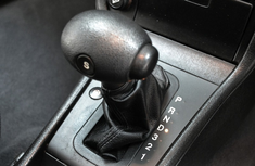 What is the function of the Low gear in automatic transmission vehicles