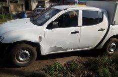 Almost brand new Mitsubishi L200 Petrol 2013