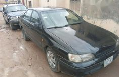 Neat Toyota Carina E 1995 Black For Sale