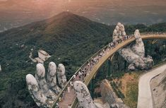 The most striking bridge in the world with 2 giant stone hands lifting it aloft