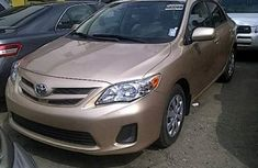 Clean Toyota Corolla 2012 Brown for sale