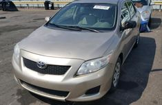 2009 TOYOTA COROLLA BASE GOLD FOR SALE