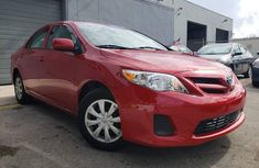 Clean Toyota Corolla 2012 Red for sale
