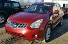 Nissan Rogue 2009 red for sale