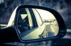 How can I use mirrors effectively for safe driving?