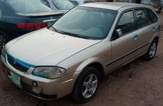 A Sharp Clean Mazda 323F 2004 Gold For Sale