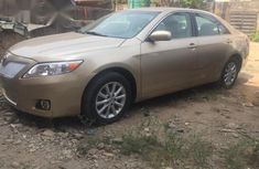 Tokunbo Toyota Camry 2011 Gold for sale
