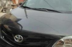 Toyota Corolla 2013 Black for urgent sale
