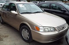 Buy and drive Toyota Camry 2001