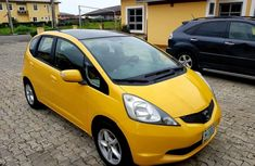 Honda Jazz 2009 Petrol Automatic Yellow for sale